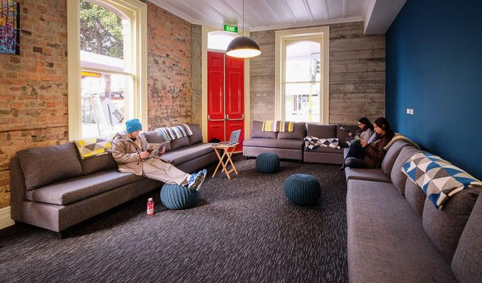 Spacious and comfy lounge at Haka Lodge Auckland