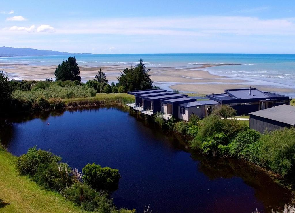 Stunning location for The Waters near Motueka on New Zealand's South Island. Image courtesy Booking.com. Click for more information on The Waters