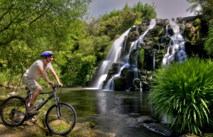 Biking at Owharoa falls picture courtesy Tourism Coromandel