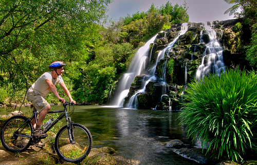 Biking at Owharoa Falls - picture courtesy  Tourism Coromandel