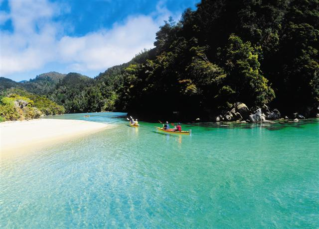 Kayaks in the stunning Abel Tasman National Park