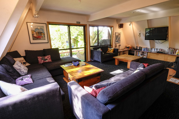 Relax in the spacious lounge at Haka Lodge Christchurch