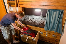 Comfortable dorm beds at Haka Lodge Queenstown feature lockable storage