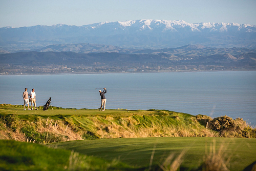 Teeing off at magnificent Cape Kidnappers - pic courtesy Miles Holden