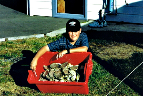 Our son Tim with a catch of scallops at Marahau
