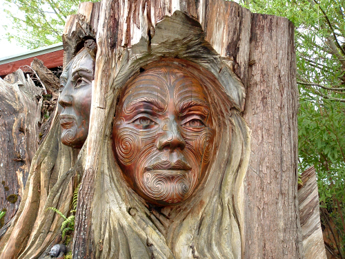 Carving of a Maori face near Marahau in the Abel Tasman National Park