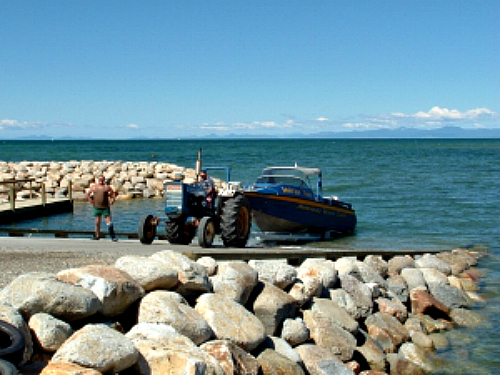 A tractor launching a boat at Marahau