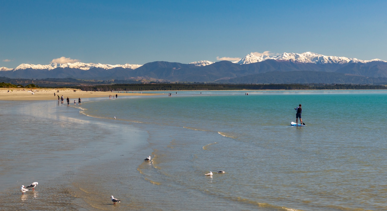 Winter paddle boarding at Tahuna beach Nelson. Picture courtesy nelsontasman.nz