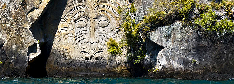 Amazing Maori rock carvings at Mine Bay - pic courtesy Viator - click for more information on how you can see these amazing carvings