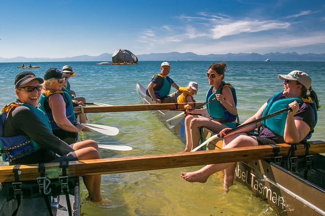 Happy visitors to the Abel Tasman National Park for the Waka Paddling Tour. Click for more information.