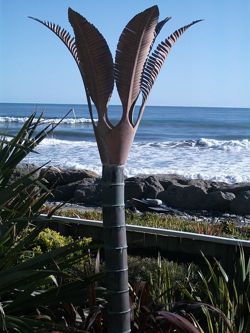 Sculpture in the yard at Wave Watchers holiday cottage Punakaiki