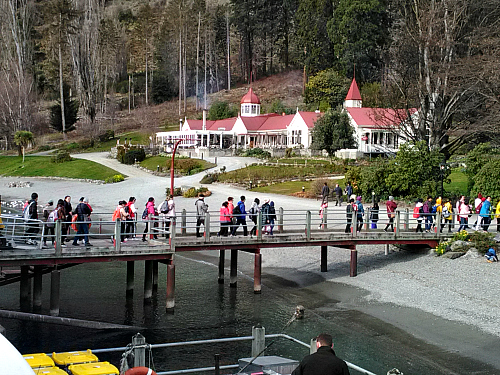 Passengers leaving the TSS Earnslaw at Walter Peak Station on Lake Wakatipu near Queenstown