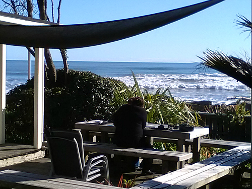 Relaxing on the extensive decks at Wave Watchers Punakaiki