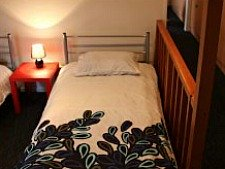 Bunk free zone! Comfortable beds in the dorm at Haka Lodge Christchurch