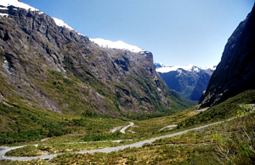 The Milford Road winds its way through prehistoric valleys towards Milford Sound