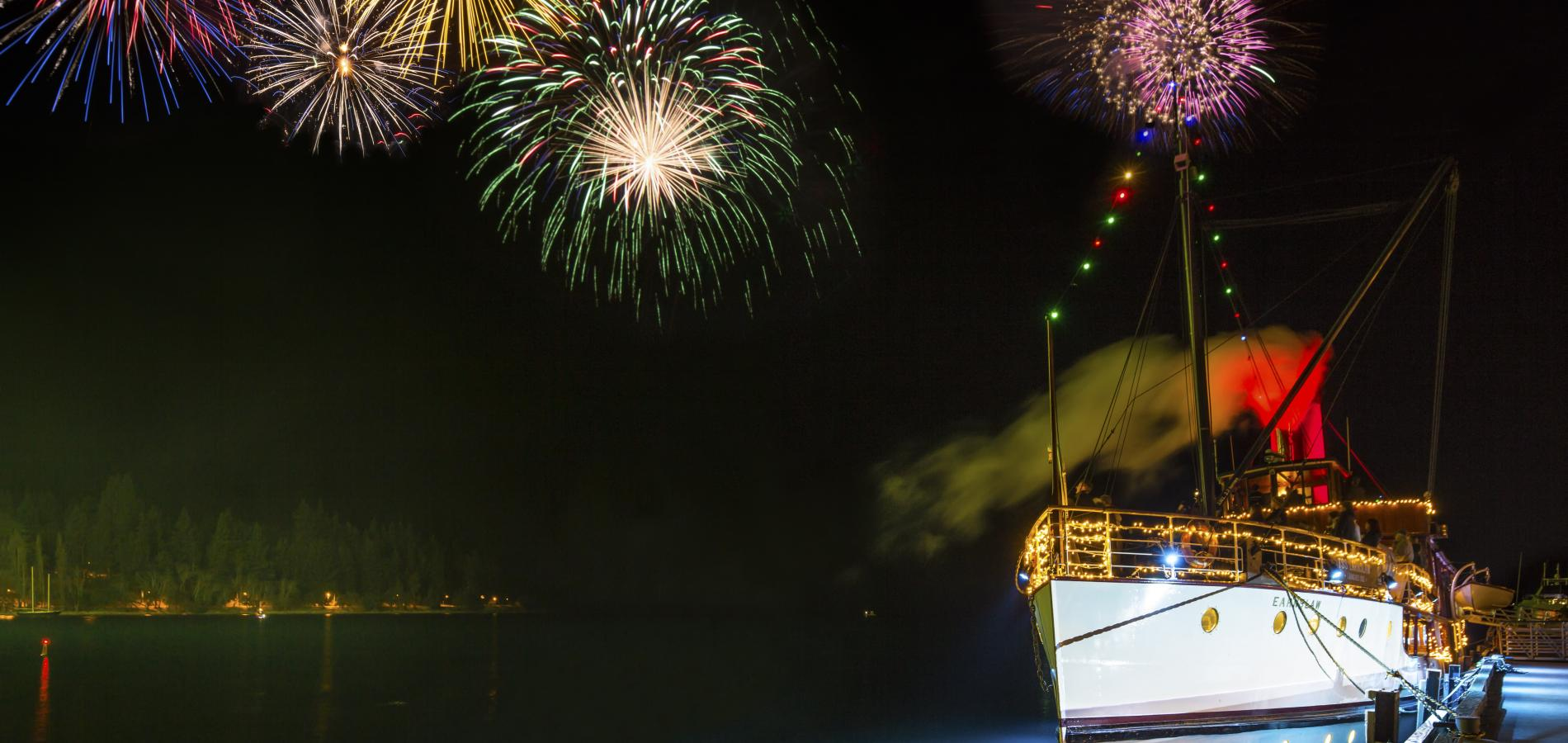 The Real Journeys Queenstown Winter Festival - fireworks over Lake Wakatipu with the historic steamer TSS Earnslaw in the foreground