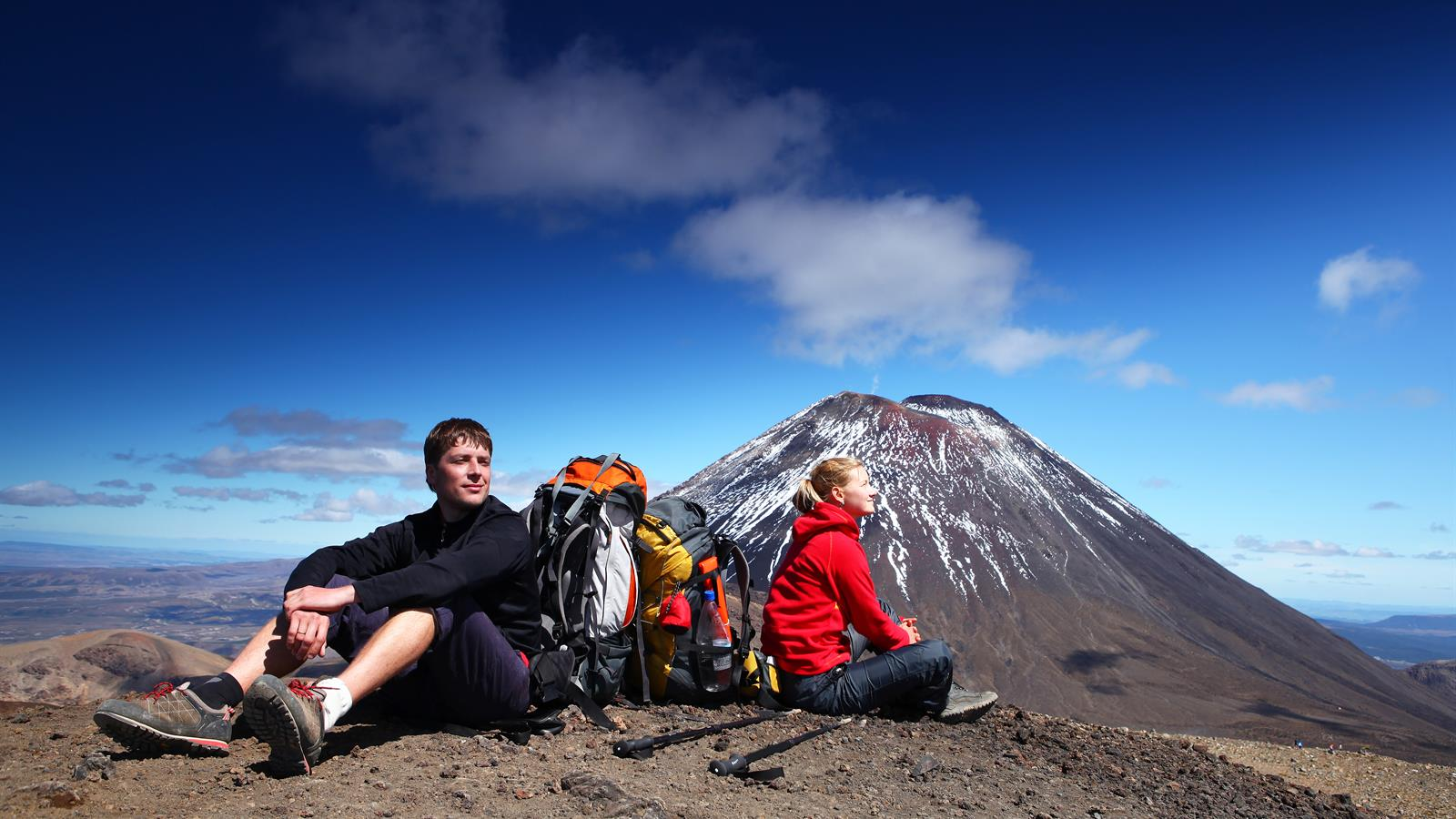 Taking time to admire the view on the Tongariro Alpine Crossing. Pic courtesy tongarirocrossing.org.nz